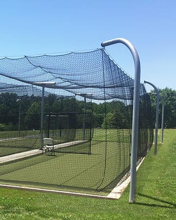 batting cage in a field