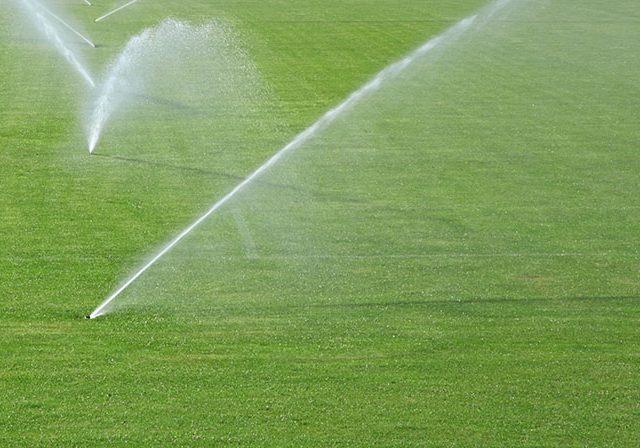 sprinklers going off in soccer field