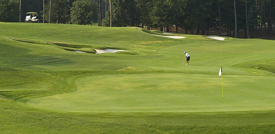 gentleman golfing on golf course