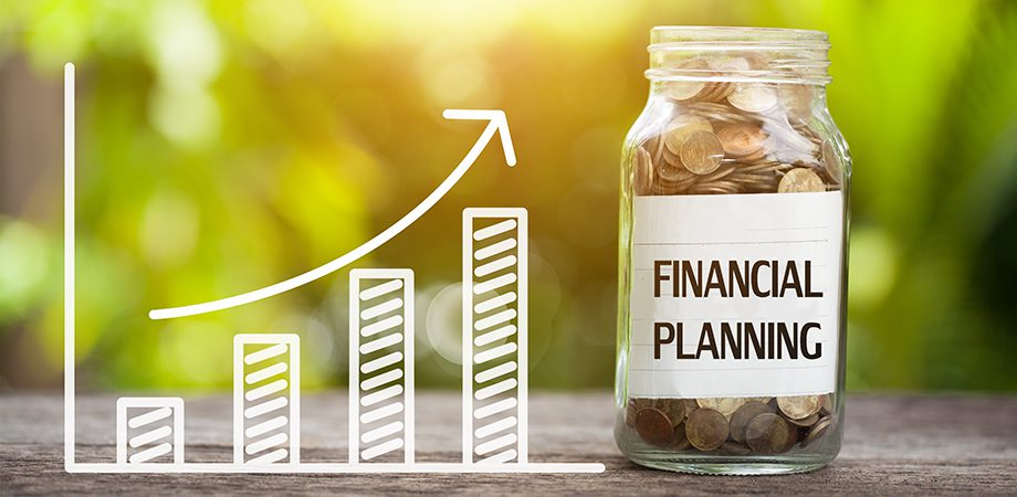 Financial planning word with coin in glass jar and graph up.