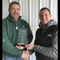 Chris Libbert smiling with his award