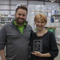Terri Weiss holding her award