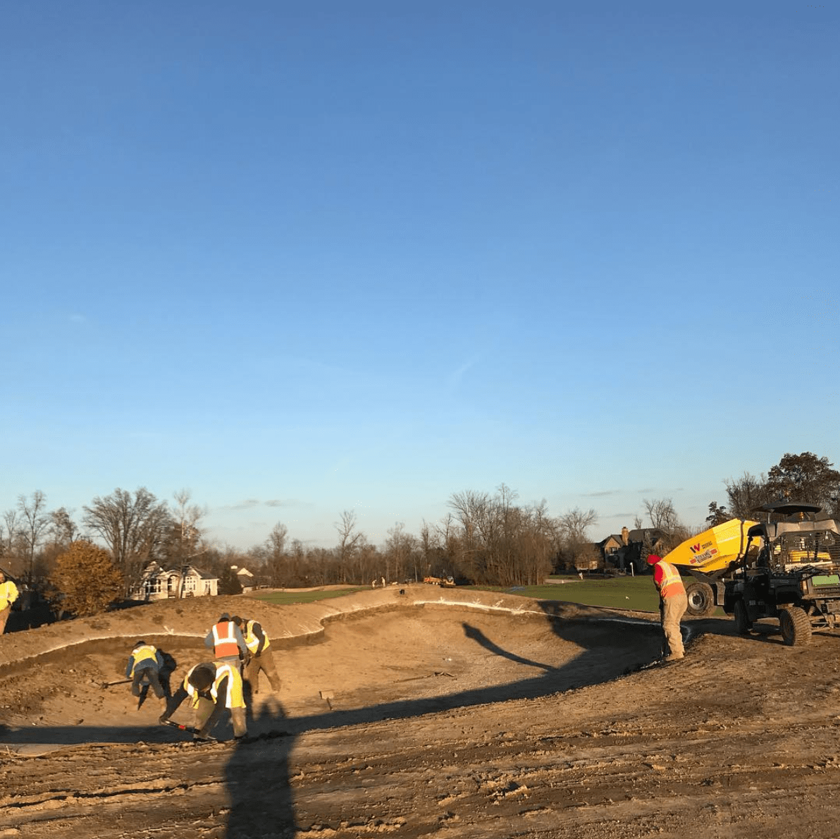close up of construction workers working on new bunker