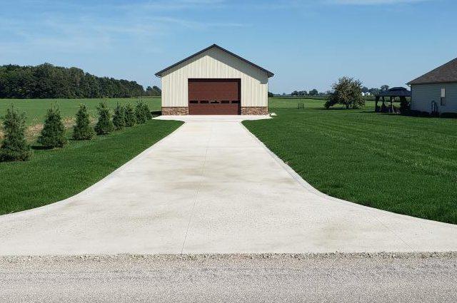 front view of garage with fresh green grass around it