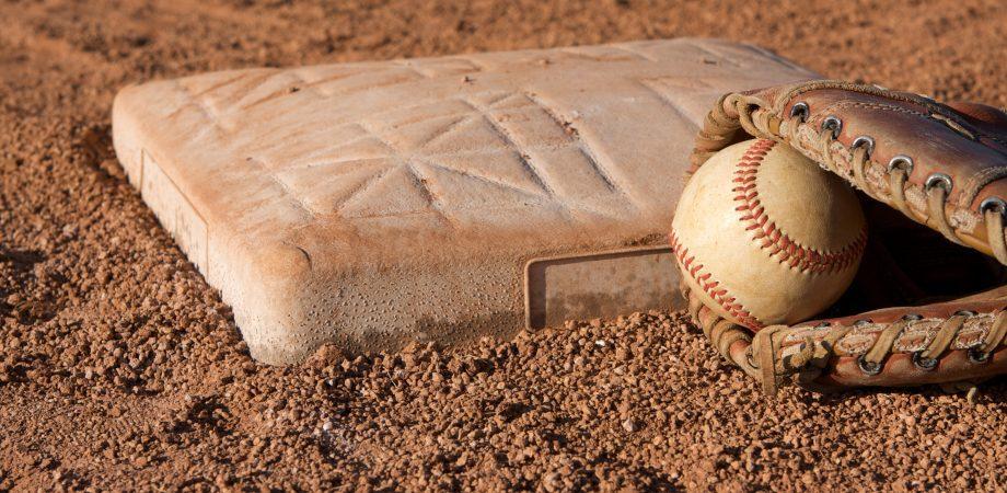 Baseball and glove near base