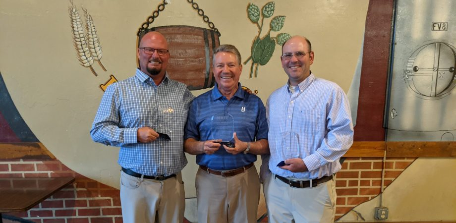 Jim Hess and two other recipients pose with their awards
