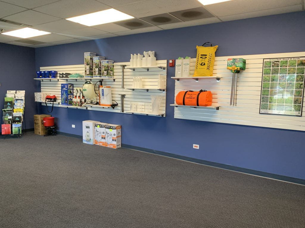 Showroom with blue walls and white shelves with products
