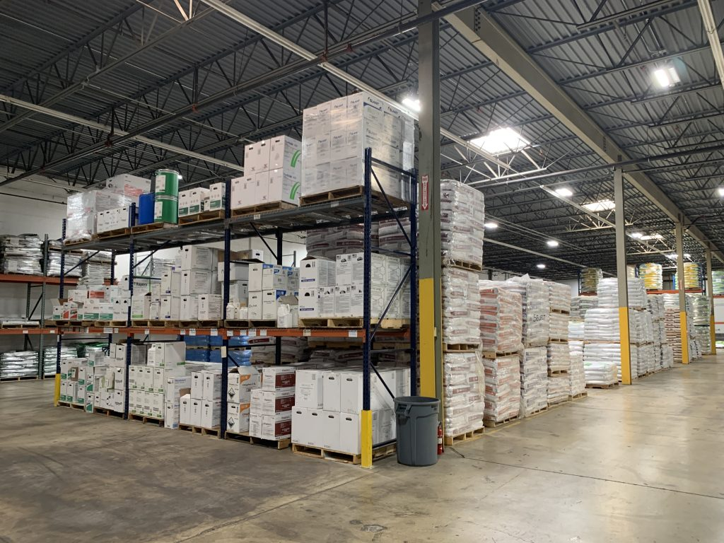 Stacked pallets of products in the warehouse