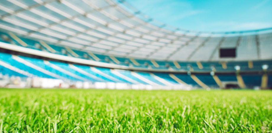 Closeup of a green football field.